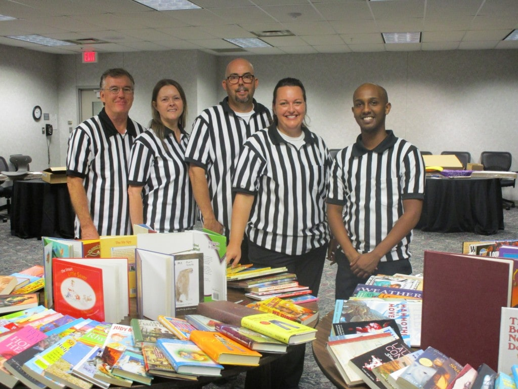 refs 5, refs standing in frot of a bunch of books