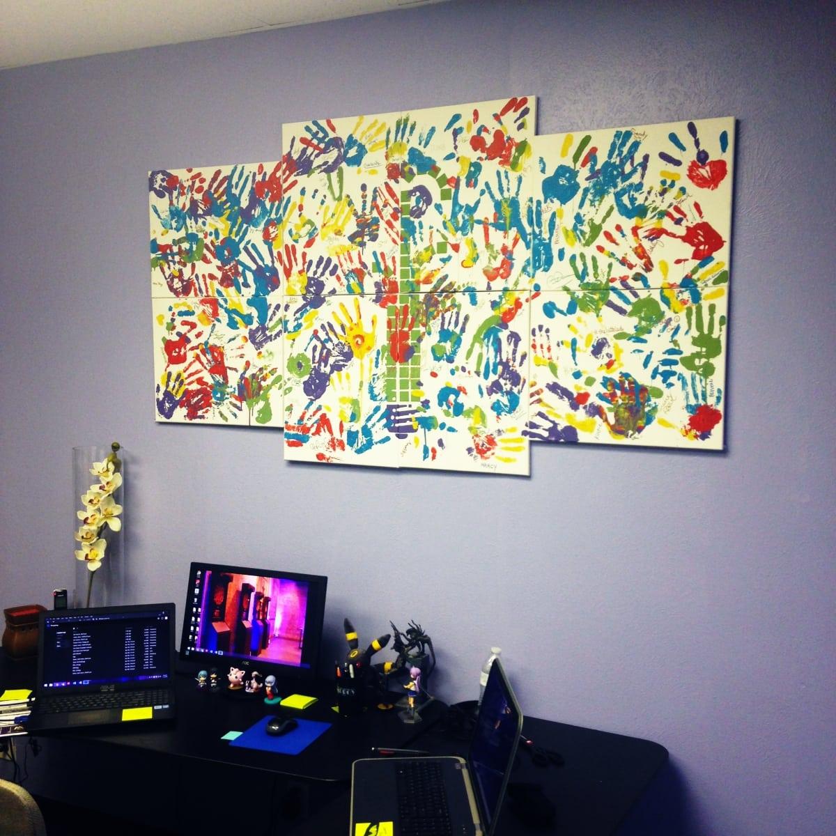 IdeaFountain LendAHand 02, painting above desk