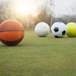 balls, basketball and 3 soccer balls outside