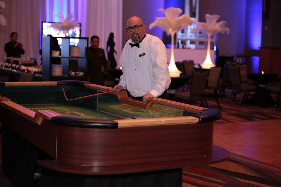 Charles 50th, man standing at a craps table
