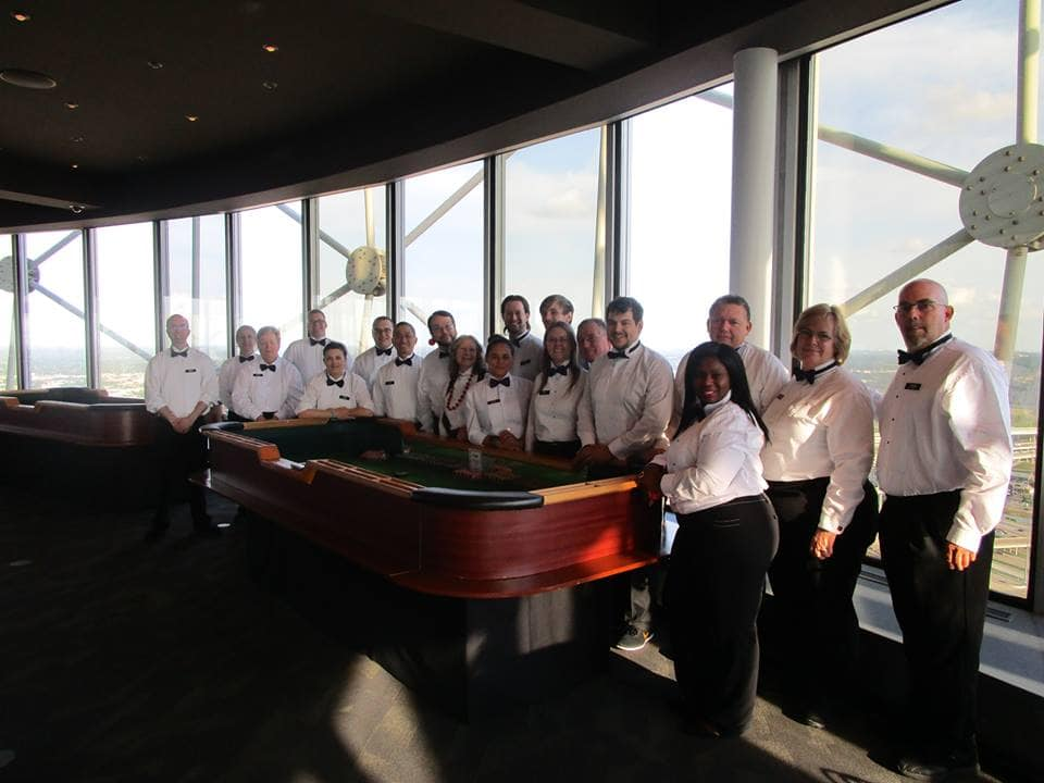 Reunion tower 5 years, dealers stanging around a craps table