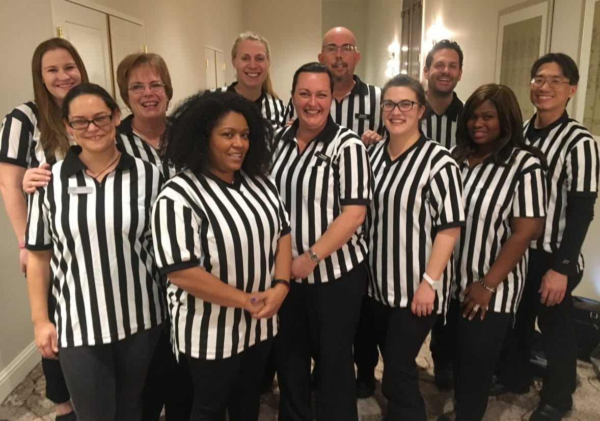 refs 1, people in ref shirts