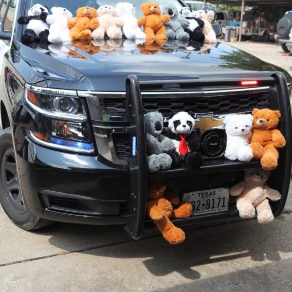 cop car teddy beears, cop car decorated with teddy bears