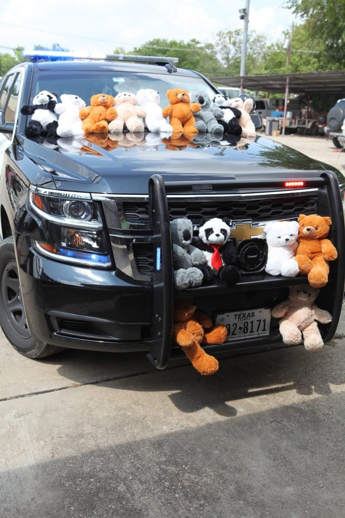 cop car teddy beears, cop car decorated with teddy bears