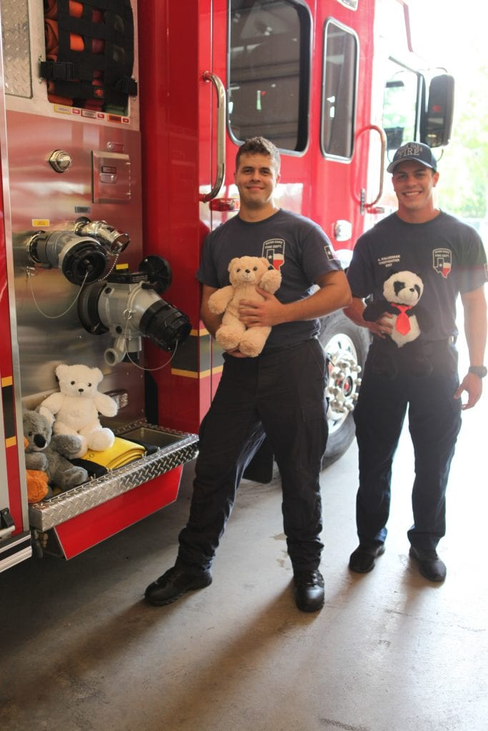 Bear blog, firemen holinf stuffed bears