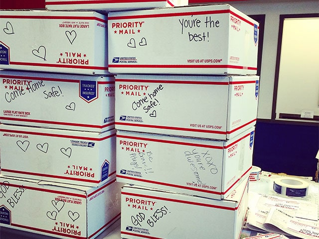 Military Care Packages, USPS packages stacked at a post office