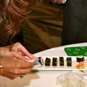 Sushi Roll, person rolling sushi