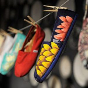 Toms Shoes, slippers haning up on a line
