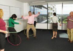 adults playing hula hoop